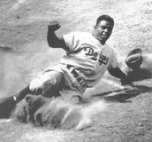 Jackie Robinson Sliding into home.