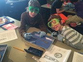 Thomas and Jacob in the middle of their worm dissection