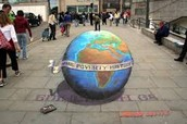 """3D Globe with a sign saying """"MAKE POVERTY HISTORY"""""""