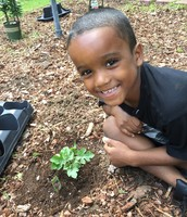Ladae'vion and the Watermelon plant he planted.