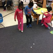 "Using our feet to measure how far the ""snowball"" went."