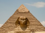 Egyptian pyramid and statues