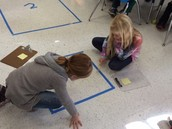 Measuring our floor tiles!