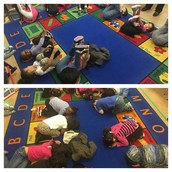 PreK Panthers in Ms. Kyler's class practice their yoga poses!