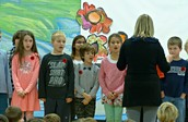 Grade 3 students remember with a song