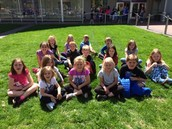 First graders enjoy a rest before boarding busses and heading back to school.