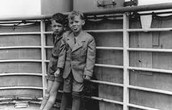 A pair of kids on the deck of St. Louis