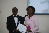Chidinma Joy, a Literacy Fellow - receiving her certificate of fellowship from the Team Lead