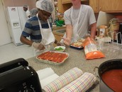 Monte and Kyle adding toppings
