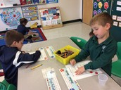 Playing shake and spill to join numbers together for math!