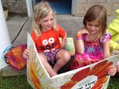 Bella and Emmy reading The Tiny Seed by Eric Carle