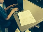 Typing our poems on the Chrome Books!