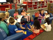 Mrs. Cole's class reads quietly in the library.