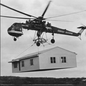 They use Helicopters to transport things like houses