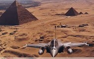 A fighter jet overflies the Egyptian Pyramids