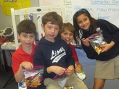 Levi, Miles, Mason, and Tahel enjoying their 100 day trail mix snack!