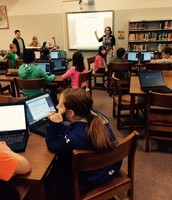 Mrs. Yutzy supports 5th graders as they create a personal Weebly site.