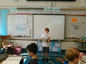Liam presenting his Poet of the Week.