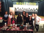 A cast of characters enjoys dinner