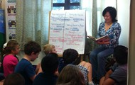 Principal Today! guest Angeline Nguyen reads aloud to third grade students...