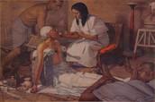Egyptian giving someone medicine