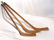 What were the first hockey sticks like?