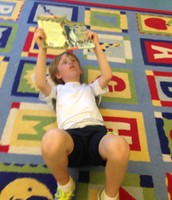 Ben choosing to read in a comfortable place.