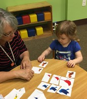 During Learning Stations, Renee works with each kiddo on s-m-l.