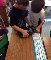 Second Graders Learning on an iPad
