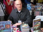 Gordon signing some books