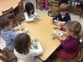 Fine motor practice with marbles!