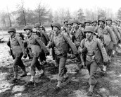 Soldiers marching off to fight