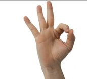 It is considered rude to point with your finger. It's better to use the whole hand.