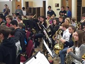 Wind Symphony Students with 8th Grade