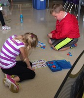 Center time- letter matching with magnetic letters.