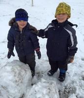 Happy boys in new fresh snow!