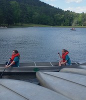 Rachel and Hannah bringing in their canoe! Great job!