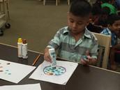 Students create dot artwork