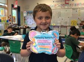 Joey showing off his butterfly book