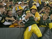 Aaron Rodgers does the Lambeau Leap!