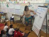 "Kim teaching students to ""Unfreeze"" characters."