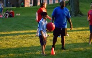 Let the kickball coaching begin with our Housemaster Jason