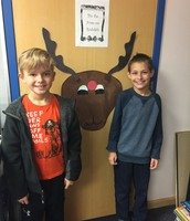 John and Brody with Pin the Nose on Rudolph