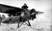 Ben Eielson stands in the cockpit of the Lockheed Vega
