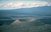 How are cone volcanoes formed?