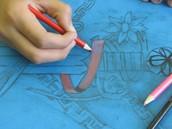 Joey shading his drawing.