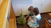 decorating a tree in the dramatic play house area