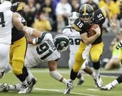Jake Rudock runs past Michigan St.'s Defense.
