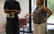 Pam Herren, Clinic Admistrator interviewing a prospective patient