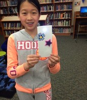 Showing off her LED bookmark!